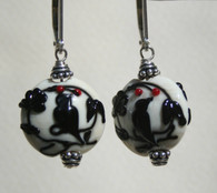 Black dove lampworked lentil shaped earrings