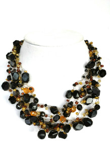 "#AN51 Hand crocheted multi strand assorted black beads with faceted amber colored Czech crystal accents  Price: Length 18"" @ $155. --20"" @ $160. -- 25"" @ $175."