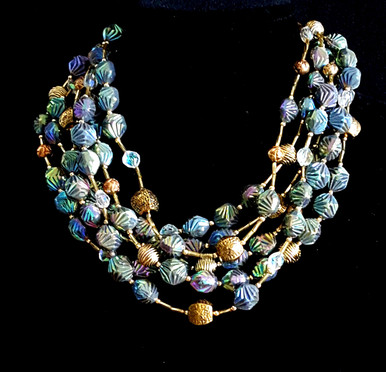 """#AN29 Dramatic Multi-Strand Iridescent Green Beads with Gold and Crystal Accents. These lustrous  beads pick up multiple colors depending on what you are wearing. Price  18"""" @$158.   , 22"""" @ $ 160.,  25"""" @ $170.,  30"""" @ $185."""