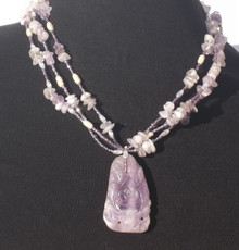 "#AN53 Fabulous Carved Amethyst Pendant with Multi Strands of Amethyst Chips, Pearls and tiny Glass Beads as accents.  Length  including pendant  20"" @ $165.  --  25"" $175."