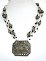 """Vintage Etched Silver Pendant on Multi Strands of  Vintage etched beads with crystal and onyx  18"""" long $158."""