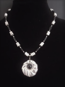 "# AN52 Silver Pendant with Onyx Stone, hanging from a  single strand of  Varied shapes of Black and Silver accents  18"" @ $75.   20"" @ $80.  20"" @ $80. 25"" @ $85."