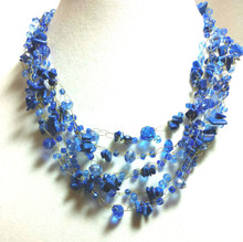 """#AN25  Multi Strand Hand Crocheted Necklace with Semi Precious lapis Chips, Czech Crystals Price: $165. Length 18"""" but I can custom make this in your preferred size for an additional charge   I hand crocheted this fabulous multi strand necklace on fine gold wire. It is delicate and shimmery but also dramatic. It seems like it wants to dance on your neck."""