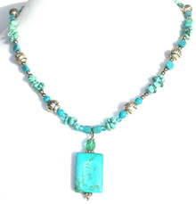 "#Bn46   Small Rectangular Semi-PreciousTurquoise Pendant hanging from a strand of Etched Silver and Turquoise chips handmade by jewelry artist Lois Becker  Price 18"" @ $65.  20"" @ $ 70.  25"" @ 75."