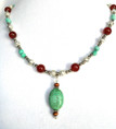 "#BN47  Hand made choker necklace  using  a Lovely Vintage Semi-Precious Chinese Turquoise Pendant hanging from a delicate single strand of Etched Silver and  semi precious Jasper  Price  18"" @ $85. 20"" @ $90."