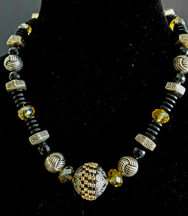 """#BN64 Elegant Centerpiece of Detailed Etched  Silver Embellished  with Amber colored Rhinestone beads Embedded into a Black Enamel background. Surrounded by intricate Etched Silver, Faceted Amber Colored Crystal  and Black Beads.  $155. @18""""  / $160. @ 20"""" / $175. ,  @ 25"""""""