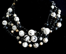 "#AN34 Make an Impression wearing this  Chunky Choker that will Fill in Any Neckline. Chunky and  Hand Made Using Dramatic Black and White Marbleized Beads of all Sizes,  Shining Black and Silver Beads it makes a Fashion Statement. Price 18"" @ $158. -- 20"" @ $160.  ---25"" @ $165."