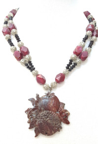 "#BN68 Unusual Necklace with a Carved Burgundy Soapstone pendant on a Double Strand of Burgundy acrylic beads with intricate Silver Filigree accents price  18"" $125. 20"" @ $135.  25"" @ $150."