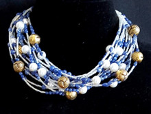 "#AN32 Important Necklace Hand-made with  Multi strands of brilliant blue sodalite and large  white pearls with unusual textured  twisted  gold accents Price 18"" 155. 20"" $165."