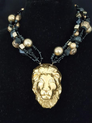 "#BN76 Be Daring. Be Unique. Bring Out the Animal in You!  This Fabulous Pendant of a Hand Made  Ceramic Gold Lion's Head on multi Strands of Gold and Black Beads will be Noticed! "" This is a One-of-a-Kind Necklace. 20"" @ $150.  25"" @ 155."