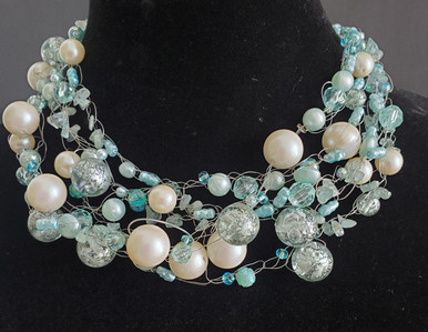 """#AN69 Necklace of Interesting Translucent Aqua beads, Large Pearls and assorted beads hand crocheted and  Light weight and very fashionable Price 18"""" @  $165. / 22"""" @ $ 170./ 25"""" @ $185."""