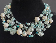 "#AN69 Necklace of Interesting Translucent Aqua beads, Large Pearls and assorted beads hand crocheted and  Light weight and very fashionable Price 18"" @  $165. / 22"" @ $ 170./ 25"" @ $185."