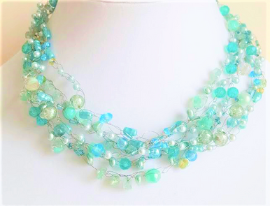 "#AN70  Lightweight and Airy  Necklace of multiple strands of assorted Aqua beads and pearls that Artist Lois Becker hand crocheted  create a delicate, simple feminine statement Price: 18"" @ $155. ---20"" @ $160.---  25"" @ $165."