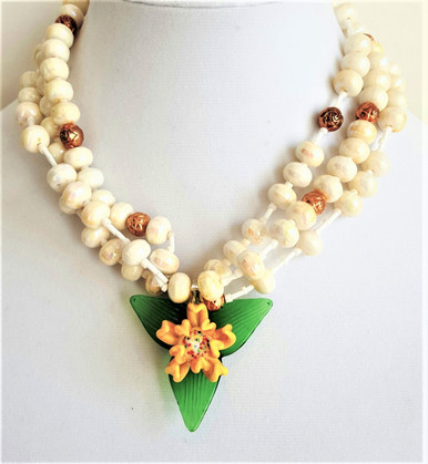 "#AN75 Flower lovers will adore  this Green and Yellow Three dimensional  Hand blown Glass Flower Pendant  hanging from Three Strands of White Pearlized Lacquer Beads with gold flower accents 18"" @ $65. , 20"" @ $68., 25"" @ $70."