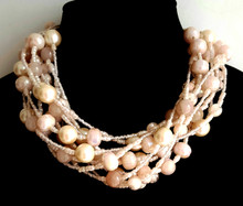 "#BN93 Handmade necklace made with Multiple strands of large cream colored pearls,  Rose Quartz, Blush Pink Lacquer Beads and tiny pink crystals .  This Lightweight but Bulky Choker makes a Fashion Statement and will fill in any neckline with grace Price: 18""@ $135. and  20"" @  $150."