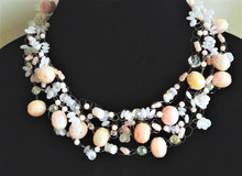 """#AN79 Delicate  Very Feminine Choker Hand Crochet  Multiple Strandsof Pale Pink Lacquer Beads, Pink Pearls, Crystals and Airy Frosted Beads. Lightweight and Delightful  Price  18"""" $155., 20"""" $160."""