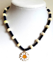 "#CN11 Daisy Pendant on a smart looking  strand of gleaming white lightweight beads with interesting NAVY BLUE spacers  18"" @ $45. -- 20"" @ $48. -- 25"" @ $50.  Earrings to match $25. Available in post, wire, or clip on"