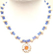 #CN4 Necklace Daisy Pendant suspended from a single handmade strand of shinny white lacquer beads with vibrant blue accents 18 in. long $48.