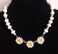 "CN5 Three Daisies on a handmade strand of Beautiful glossy White Beads, with faceted beads in between to add a bit of glamour. Lightweight and lovely.  18"" long @$48 --20"" @ $50. --25"" @ $55."