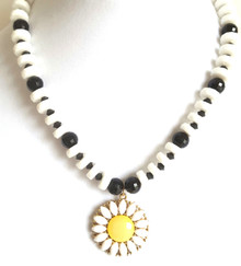 "#CN7  Daisy Pendant hung from a strand of handmade stunning Chalk White and Large Shinny Faceted Black Beads, lightweight and Fashion Forward  18"" @ $45.---20"" @ $48.-- 25"" @ $50.  Earrings to match $25. Available in post, wire, or clip on"