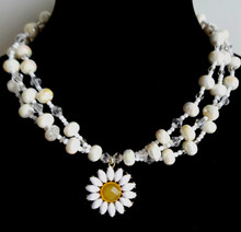 """#CN6  Fabulous Daisy Pendant suspended  by three Glamorous  handmade strands of High gloss white and crystal accent beads. This will create excitement when you add it to any outfit and make you feel special.18"""" @ $75. -- 20"""" @ $80. -- 25"""" @ $ 85."""