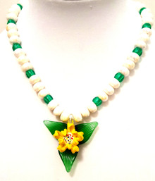 "#CN3 Flower Lovers check this out: Hand Blown Glass Flower, Three Dimensional Yellow and White Flower Pendant on a Green Leaf Background suspended from a strand of Shining White Lacquer Beads and Translucent Green Beads.  Cost: 18"" @ $35., 20"" @ $40., 25"" @ $50."