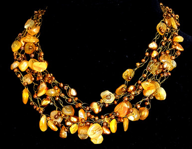 "#CN21  Jewelry Artist Lois Becker made this One-of-a-kind Hand Crochet Necklace on Multiple Strands of Semi-Precious Golden Agates with Copper Colored Accents for the Woman who loves Wonderful Fashion Accessories. 18"" @ $165.  20"" @ $170. 25"" @ $185."