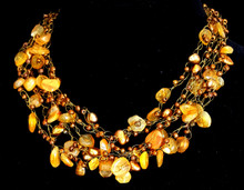 """#CN21  Jewelry Artist Lois Becker made this One-of-a-kind Hand Crochet Necklace on Multiple Strands of Semi-Precious Golden Agates with Copper Colored Accents for the Woman who loves Wonderful Fashion Accessories. 18"""" @ $165.  20"""" @ $170. 25"""" @ $185."""