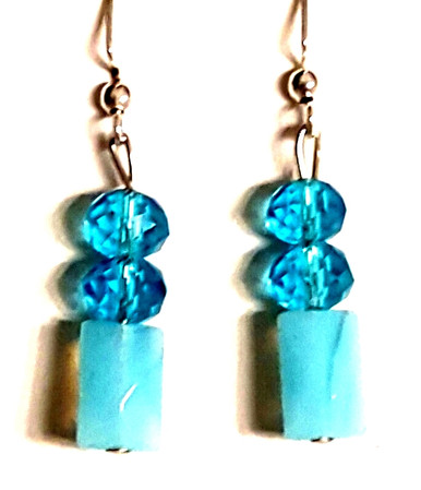 #B41  Delicate Feminine Aqua colored Earrings with two gleaming faceted Aqua tinted Crystal beads $25. Available in wire, post or clip on $25.
