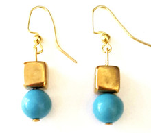 #A2 Vivid Turquoise Colored Glass with unique Square gold Bead $25. Available in wire, post or clip on