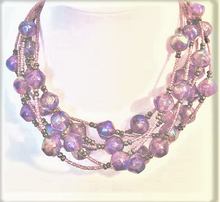"""#AN11  Multiple strands of Translucent Purple Make a Wonderful Fashion Statement and Fill in a Bare Neckline $95. 18""""   or 20"""" long $110. -- 25"""" @ $125. -- 30"""" @ $135."""