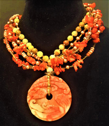 "#AN37 ONE OF A KIND Necklace made of an Exquisite and Unique Hand-Carved  Serpentine Jade Money Wheel on multiple strands of Coral and semi-precious Agate and  Leopard Jasper. This Money Wheel is carved on both sides. Toggle Clasp. 18""  $275. 20"" $280."