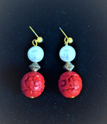 #A27 Carved Red Cinnabar with white Pearl and gold accents Available in wire, post or clip on $38 .