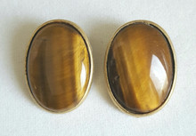 #AA6 LARGE VIBRANT SEMI-PRECIOUS TIGER EYE EARRING WITH GOLD SURROUND .  $28. AVAILABLE IN CLIP ON ONLY
