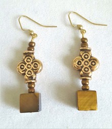 #A25 UNIQUE SQUARE CUT TIGER EYE EARRING HANGING FROM AN INTERESTING EMBOSSED GOLD BEAD .  $35.  AVAILABLE IN WIRE, POST OR CLIP ON, PLEASE SPECIFY