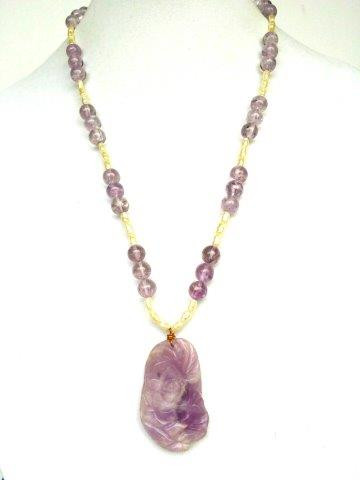 "#BN7 CARVED AMETHYST PENDANT ON A SIMPLE STRAND OF PEARLS AND AMETHYST 18"" $165. /  25"" @ $185.  / 30"" 225."