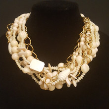 "#AN85  ONE-OF-A-KIND STATEMENT NECKLACE MULTIPLE STRANDS OF ASSORTED BONE CREAMY WHITE BEADS WRAPPED AROUND A GOLD CHAIN $165..  MEASURES 20"" or 25"" @ $175."