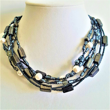 """#BN15   FOR AN ELEGANT AND REFINED ACCESSORY YOU WILL LOVE THIS:  MULTI STRANDS OF SEMI PRECIOUS DARK GRAY HEMATITE AND WHITE PEARLS 16""""  @  $150.--- 18"""" @ $155.---20"""" @ $ 158. ---25"""" @ $165. -- 30"""" @ $ 170."""