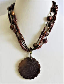 "#BN 67 ONE OF A KIND CARVED DARK BROWN JADE PENDANT ON MULTIPLE STRANDS OF JASPER . PRICE 18"" $375."