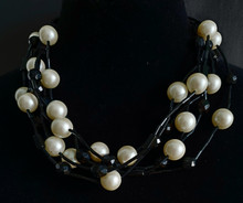 "#BN73 MULTIPLE STRANDS OF ELEGANT LUXURIOUS LARGE CREAMY PEARLS WITH FACETED BLACK ACCENTS  . PRICE: 16"" $165. , 18"" $170., 25"" $175.., 30"" $185."