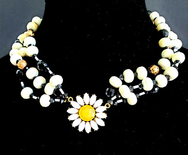"""#AN101  BRIGHT YELLOW DAISY WITH 3 STRANDS OF BLACK AND WHITE    18"""" @ $95. /  22"""" @$100/  25"""" @ $125."""