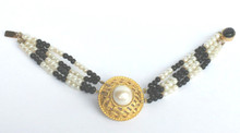 """#BR3  Bracelet  One-Of-A-Kind Hand Made Beautiful Large Pearl Encased in a  Gold Lattice Design with four strands of delicate  onyx and pearl beads, Onyx clasp  price $135.  length  7"""""""