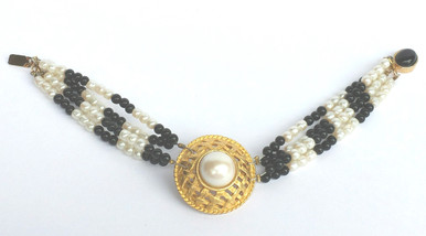 #BR3  Bracelet  One-Of-A-Kind Hand Made Beautiful Large Pearl Encased in a  Gold Lattice Design with four strands of delicate  onyx and pearl beads, Onyx clasp  price $135.  length  7""