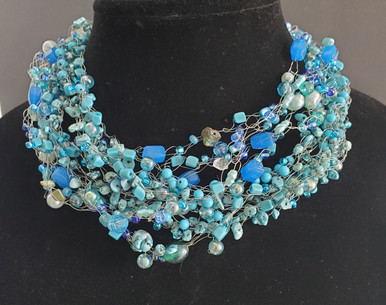 "#AN83  One-Of-A-Kind  hand crocheted by jewelry artist Lois Becker  using Multiple Lightweight Strands of Semi-Precious Turquoise, Pearls and assorted complimentary beads.  SIZE 18"" @ $175.  /  20"" @  $180.  /  25"" @ $225."