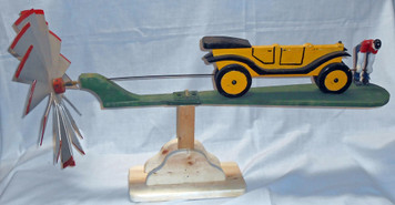 ANTIQUE  WHIRLEY JIG  - Man Cranking  Antique Car on a  Display Stand