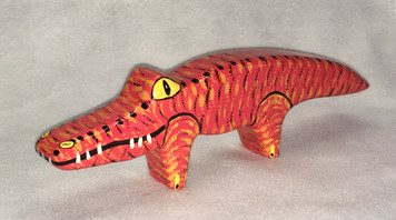RED WOODEN GATOR by Jo Ann Butts