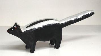 SKUNK WOOD CARVING by Jim Lewis