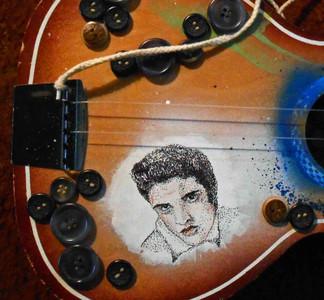 Elvis Pen and Ink Stipple Illustration on Childs Guitar