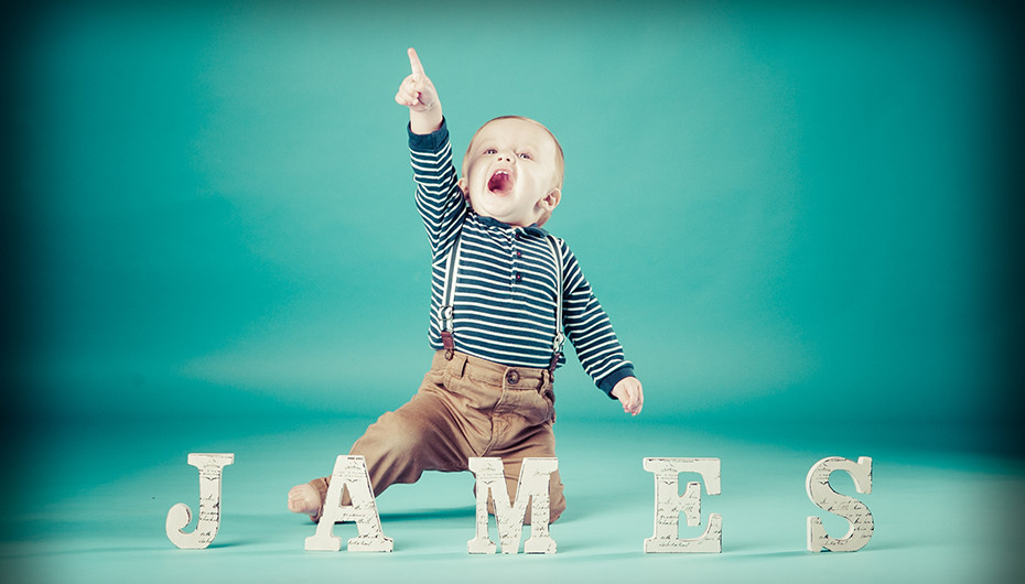 Picture of happy little boy with name against green background. Image by Emotion Studios.