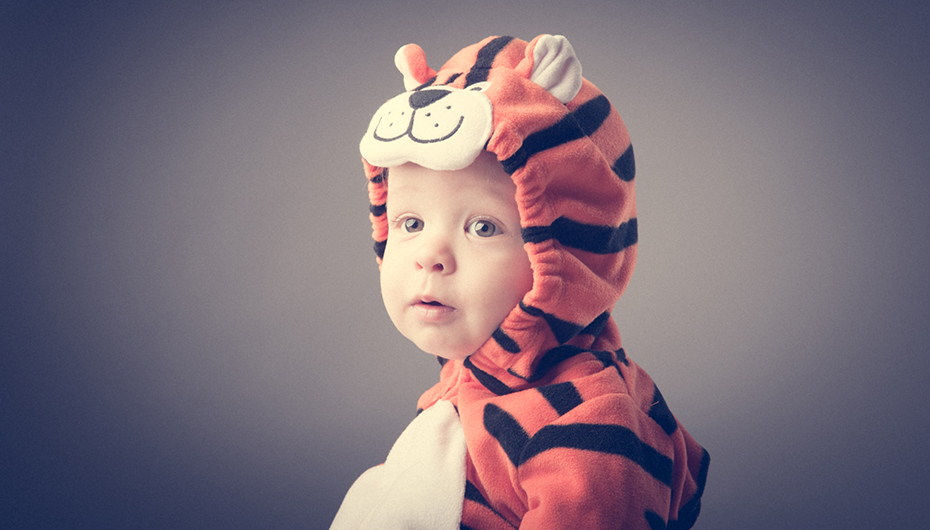 Adorable image of baby in cute costume. Photograph by Emotion Studios,